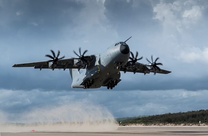 Photograph. Exterior. Day. Summer. Atlas A400M Royal Air Force Transport Aircraft lifting off and taking to the air.
