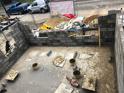 Ext. Day. Pub. High–angle view of the well-advanced blockwork
