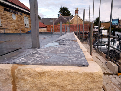 Ext. Day. Pub. Lead coping added at the top of the cavity wall.