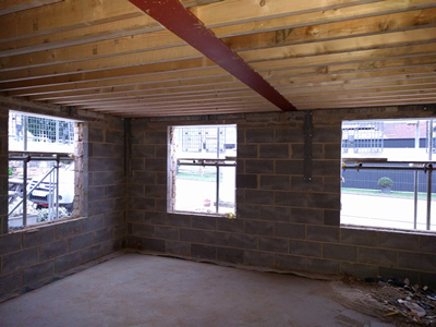 Int. Day. Pub. Interior of the room looking South East. The floor to the flat roof has been boarded.