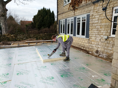 Ext.Day. Pub. Floor insulation being hand–sawn and cut to size
