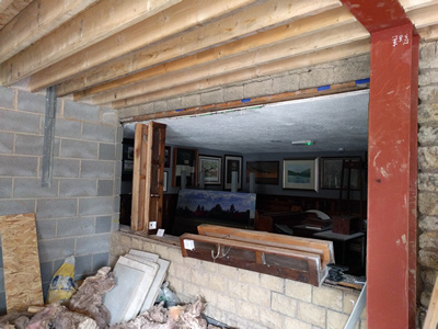 Int. Day. Pub. The removal of the existing, formerly exterior, windows thereby creating access into the newly built room.