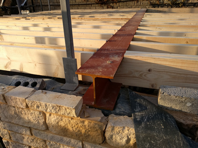 Ext. Day. Pub. End of Rolled Steel Joist supported on inner leaf of South wall.