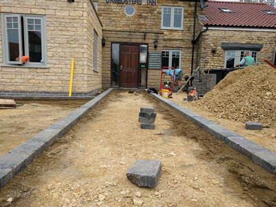 Ext. Day. Pub. Commencing the laying of Setts.