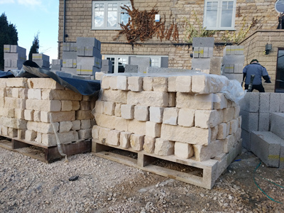 Ext.Day. Pub. Still on the delivery pallets, Natural Stone for the walls.