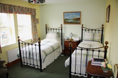 Interior. Day. A bedroom with twin single beds  in the Field View Bed and Breakfast premises.