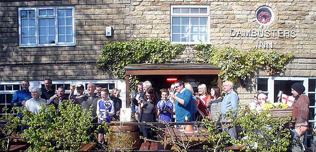 Exterior, Dambusters Inn. Customers celebrate CAMRA PUB OF THE YEAR 2016 AWARD. 23 April 2016