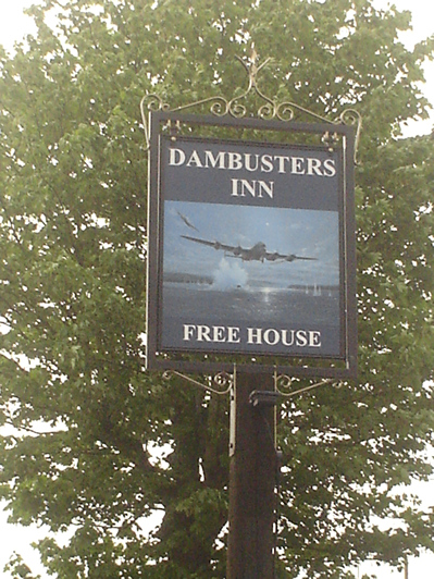 "Exterior. Day. 11 May 2018 15:52hrs. Simon Atack's ""HOPGOODS COURAGEOUS RUN"" for Dambusters Inn Pub Sign"